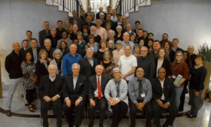 All the IPHC delegation posing for a picture in a stairwell.