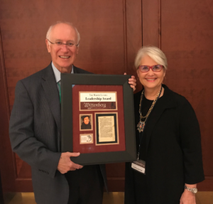 Dr. and Mrs. Doug Beacham holding the Luther award together.