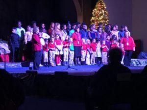 Children standing on stage.