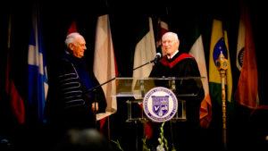 General Superintendent Doug Beacham presents the university Bible