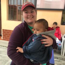 An Emmanuel Singer shoing love to a child in Ecuador