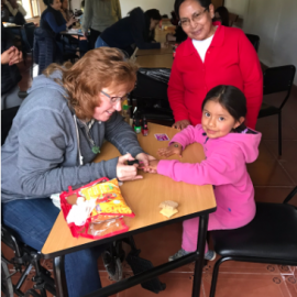 A little girl's nails being painted in Ecuador