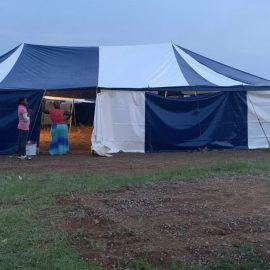 A blue and white tent used for ministry in South Africa