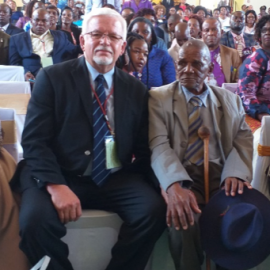 Joe Delport sitting with 98 year old First Bishop of Botswana