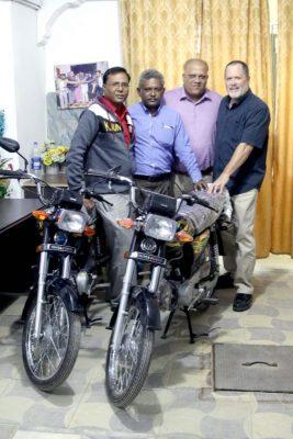Tim Presenting Motorcycles to Pakistan Pastors