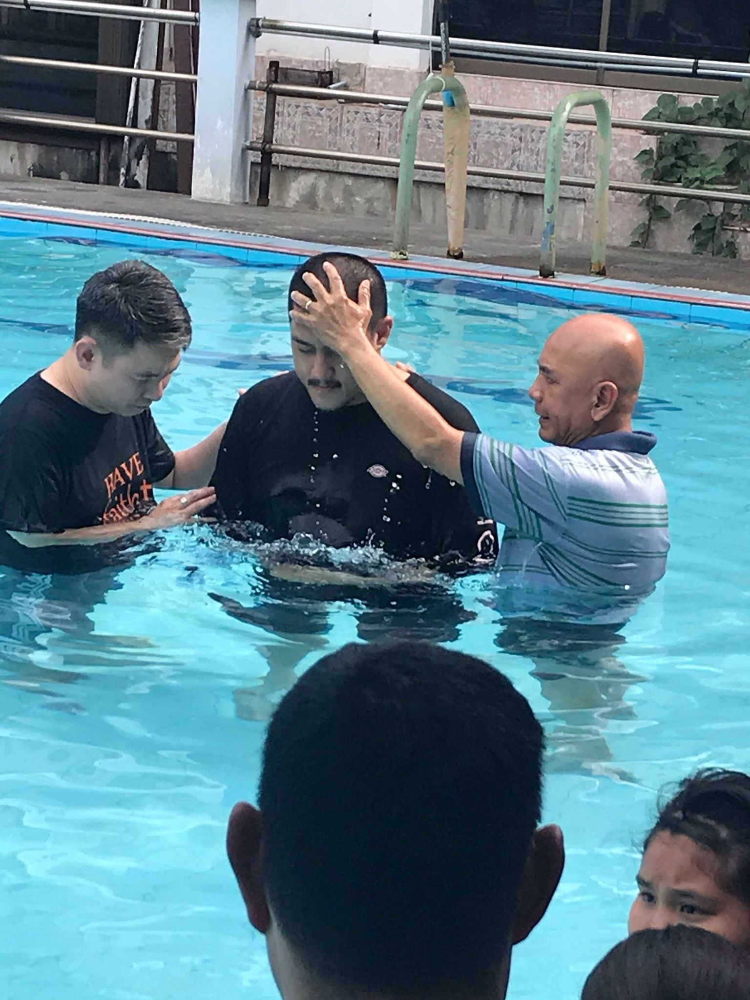Albert baptizing one of the 15 new believers from Don Muang Church.