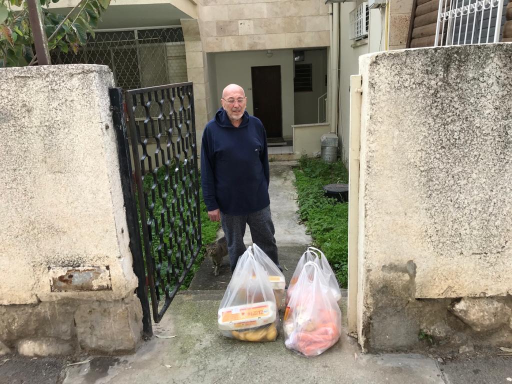 Man delivering groceries to Holocaust survivors
