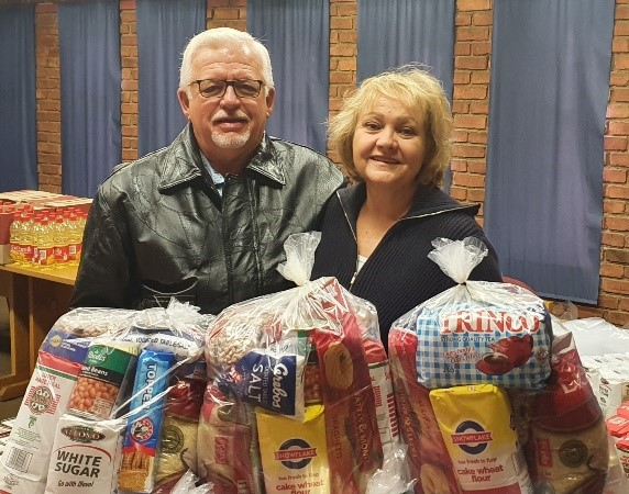 Joe and Maggie with food relief packages